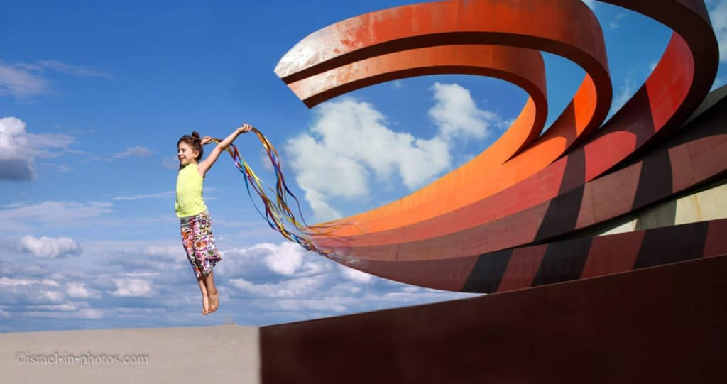 A girl with ribbons and the Design Museum in Holon