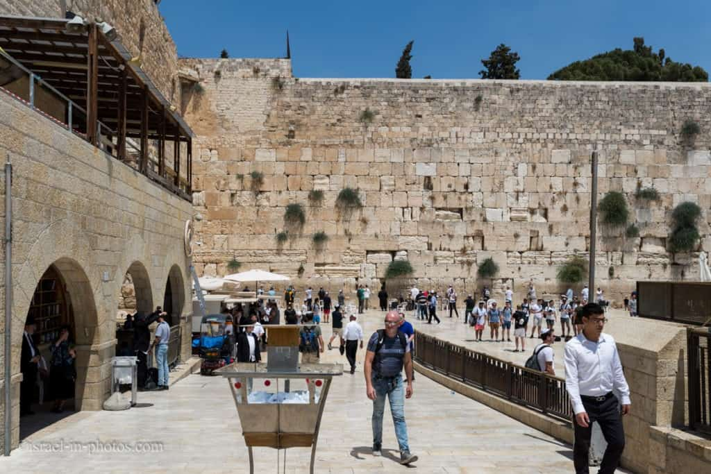 Entrance to the men's section at the Western Wall with kippah stand in the center