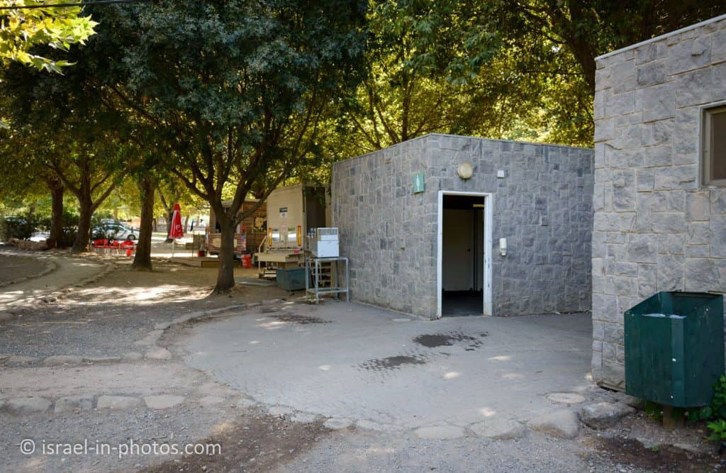 Restrooms, kiosk and the parking lot in the background